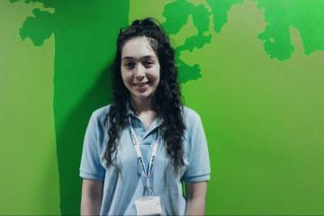 Daisy, a student wearing a blue Healthwatch polo shirt