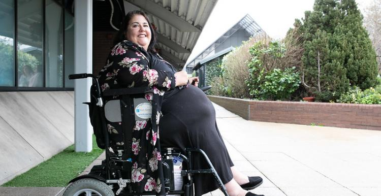 Image of a woman in a wheelchair
