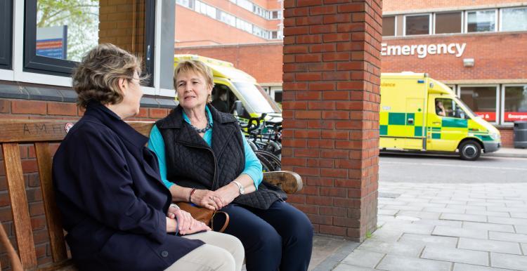 Two ladies talking outside A&E