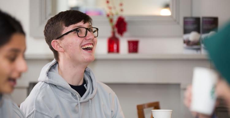 A teenage boy laughing