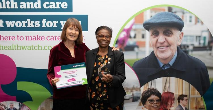 Healthwatch staff and volunteer holding award