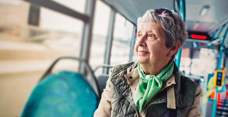 lady sitting on a bus looking out of the window