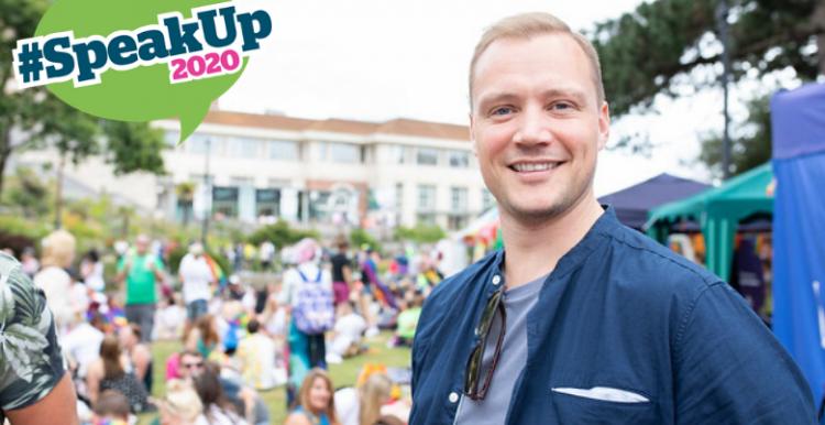 Man smiling with #SpeakUp2020 logo