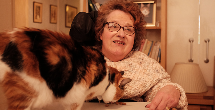 Photo of Angela with her cat