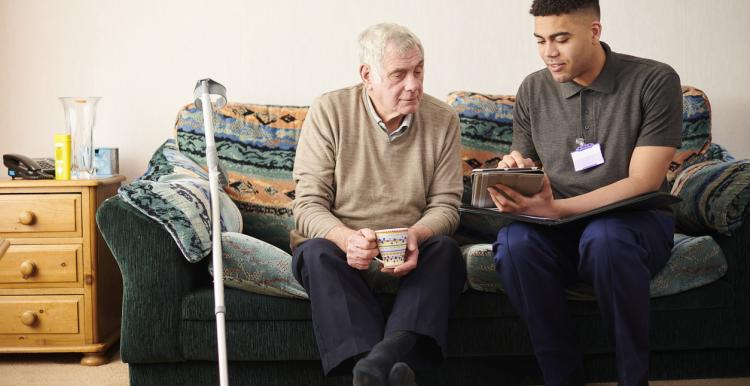 Man at home with carer