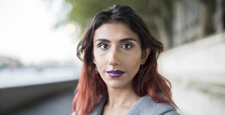 Transgender woman looking at the camera.