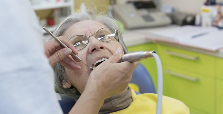 Elderly woman at the dentist
