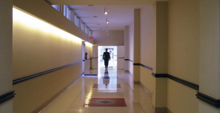 person walking down a corridor