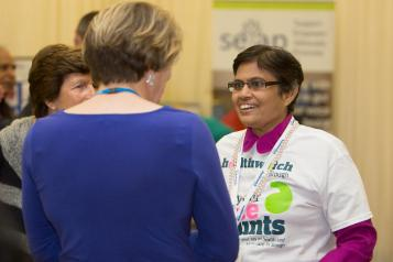 Healthwatch volunteer talking to a lady
