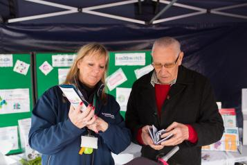 Healthwatch volunteer helping a member of the public