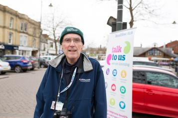 Healthwatch volunteer at a community event