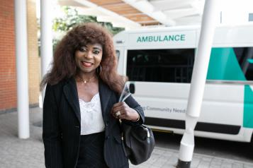 A women standing in front of an ambulance