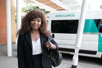 Women standing in front of an ambulance
