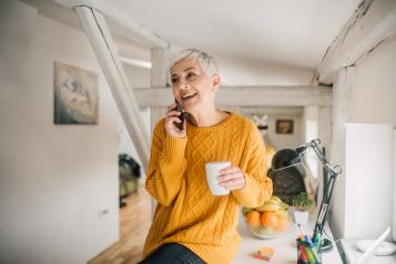 Older woman smiling on phone