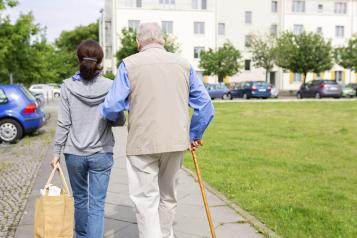 Carer with elderly man