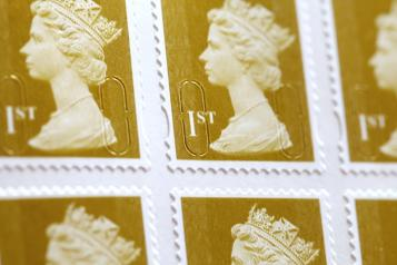 close picture of golden first class british stamps