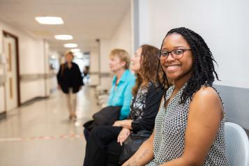 Woman smiling in a hospital waiting room