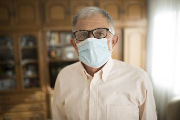 Man in care home wearing a face mask