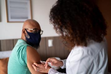 Man getting a COVID-19 vaccine