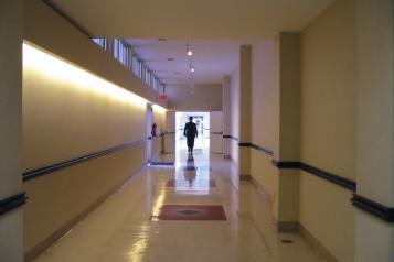 person walking down a corridor