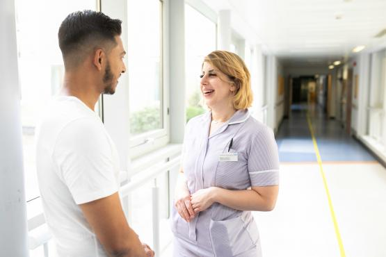 A nurse talking to a patient