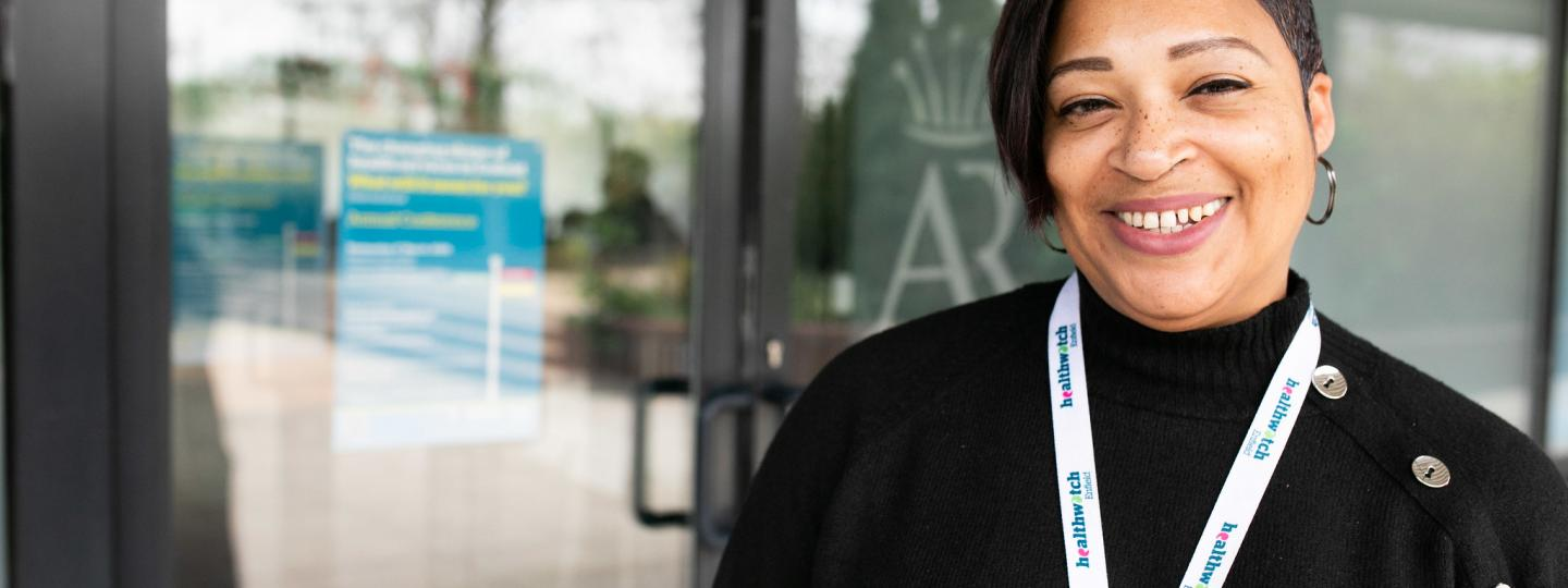 Woman wearing a healthwatch lanyard