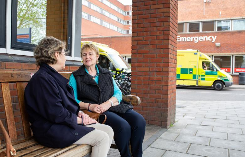 Two ladies talking outside A&E