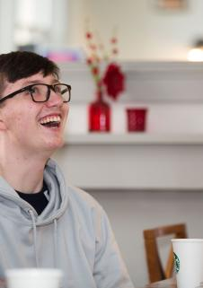 A teenage boy laughing